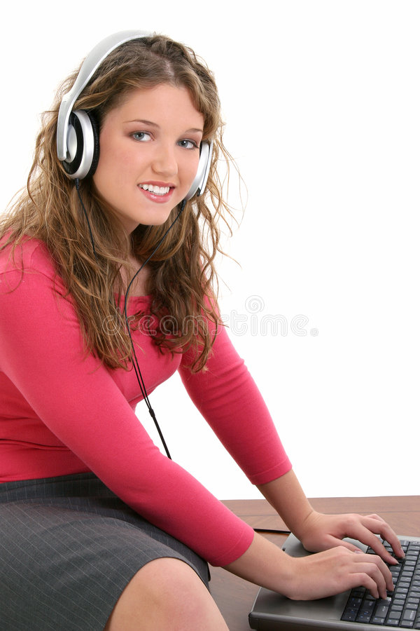 Beautiful Teen Girl with Headphones and Laptop stock images