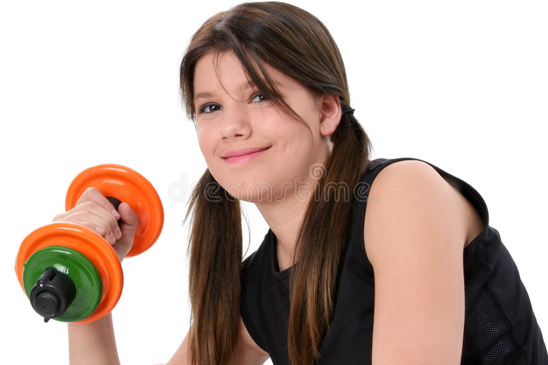 Beautiful Teen Girl Holding Colorful Weights Over White stock image