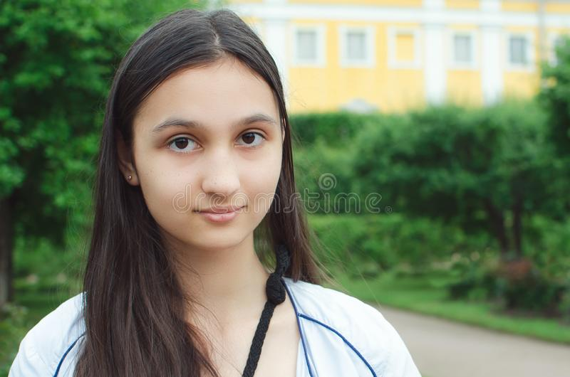 Beautiful teen girl with long dark hair, closeup portrait stock photo