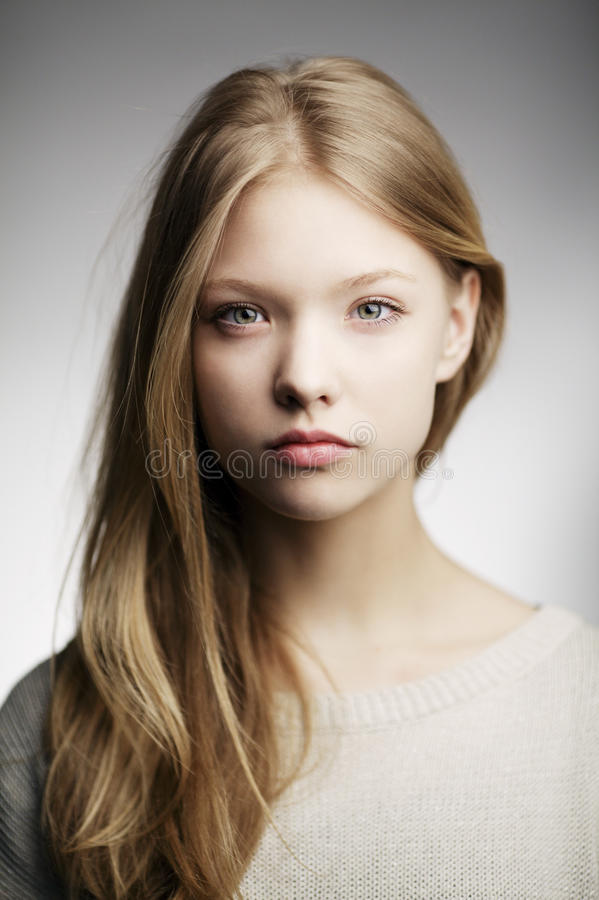 Beautiful teen girl portrait. Beautiful blond teen girl portrait stock image