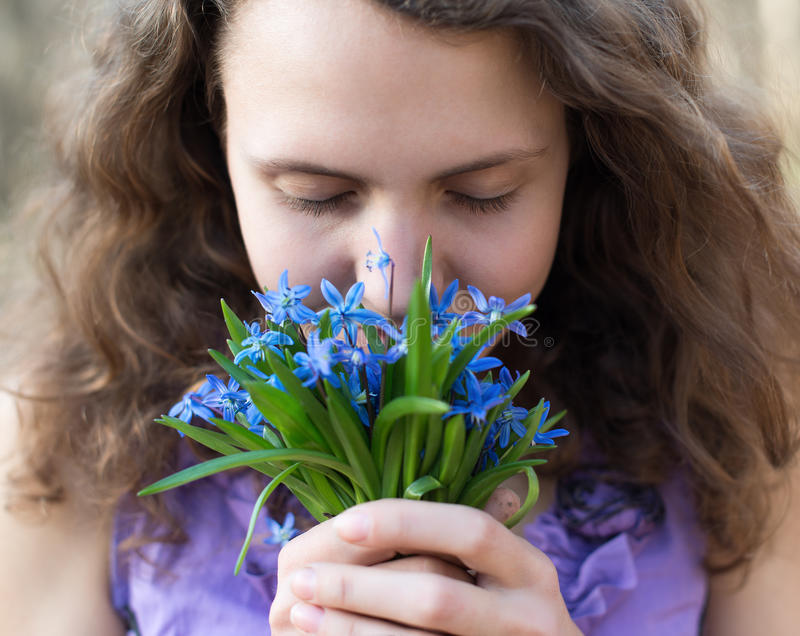 Beautiful teen girl smell royalty free stock photography