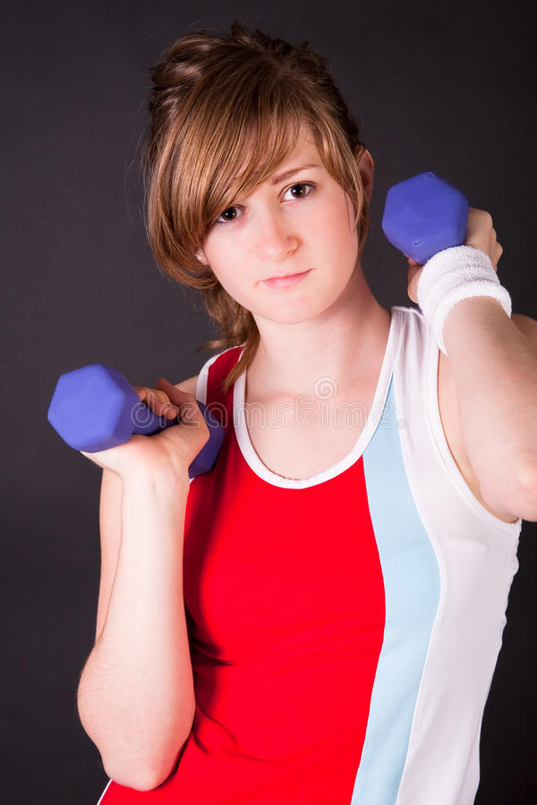Beautiful teen girl in sport dress stock photography