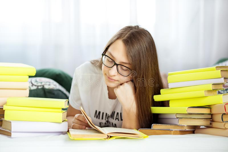 Beautiful teen girl studying in the room. Concept of education, hobby, study and world book day royalty free stock photos