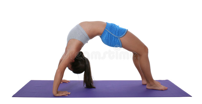Beautiful Teen Girl In Workout Clothes Doing Backbend royalty free stock image