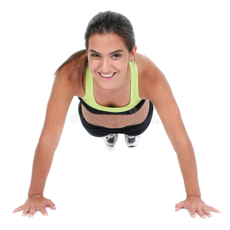 Beautiful Teen Girl In Workout Clothes Doing Pushup stock image