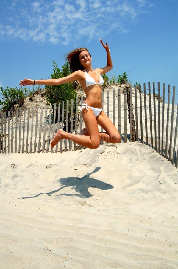 Download Beautiful Teen Jumping At Beach Stock Photo - Image: 6582004