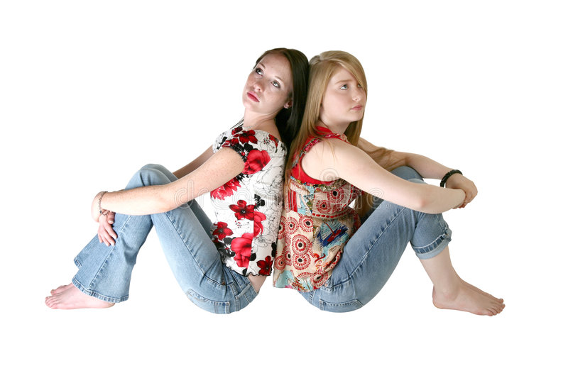 Beautiful Teen Sisters Over Wh royalty free stock photo