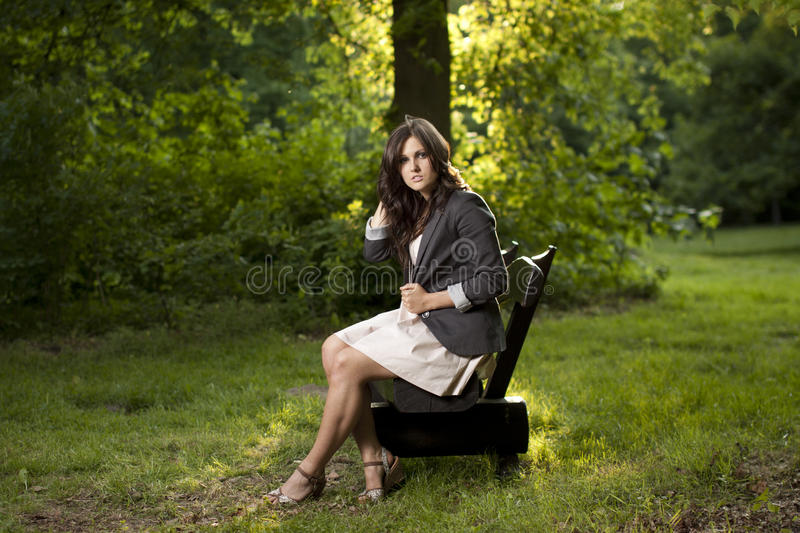 Download Beautiful Teen Sitting On A Bench In Park Stock Photo - Image: 24875892