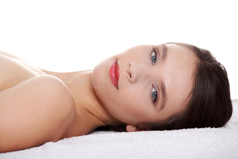 Beautiful teen woman's face with fresh clean skin. Isolated on white background royalty free stock photography