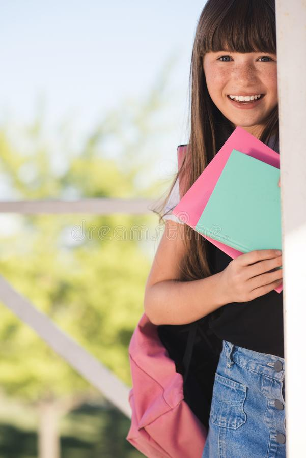 Smiling teenager with books royalty free stock image