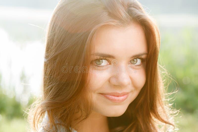 Beautiful teenage girl. Close-up portrait of beautiful teenage girl smiling looking at camera royalty free stock photo