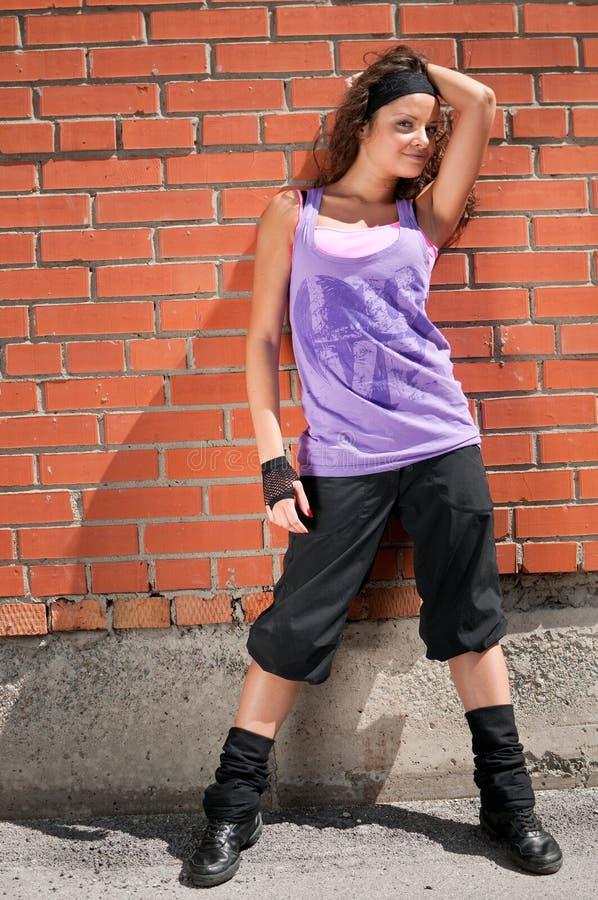 Beautiful teenage girl dancing hip-hop stock photography