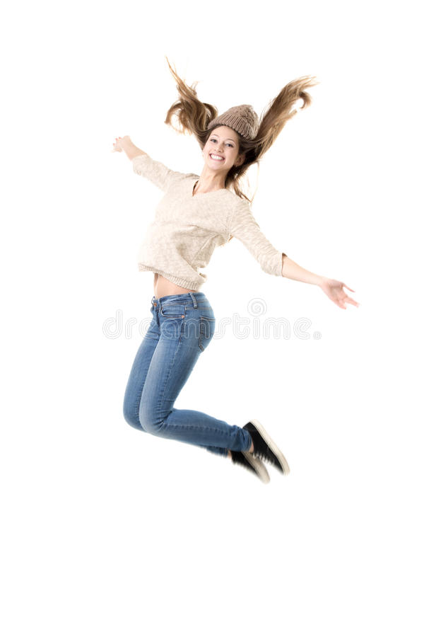 Beautiful teenage girl jumping high with delight royalty free stock photo
