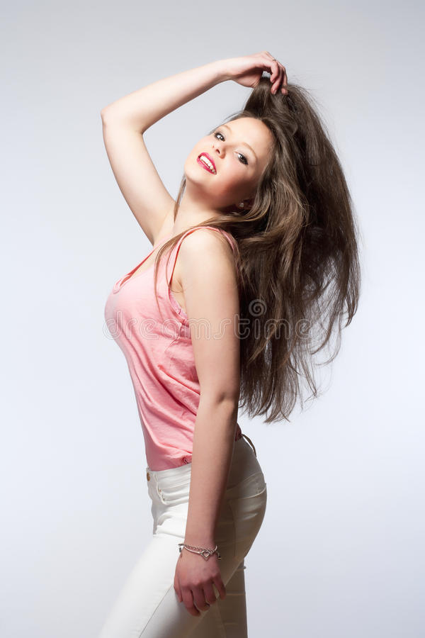 Beautiful Teenage Girl with Long Brown Hair royalty free stock photography