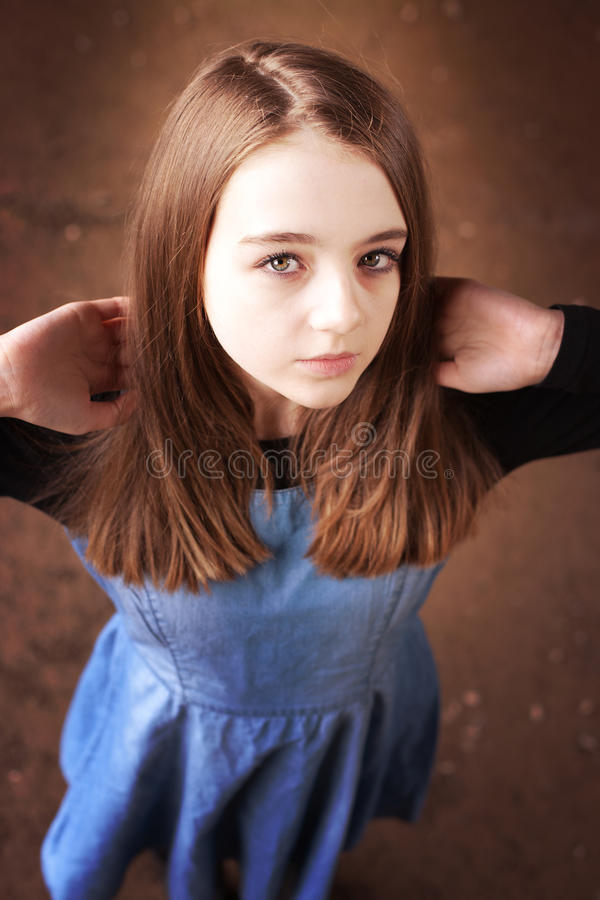 Beautiful teenage girl looking upwards stock photo