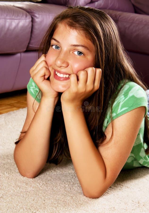 Beautiful Teenage Girl Lying On The Floor Stock Photo