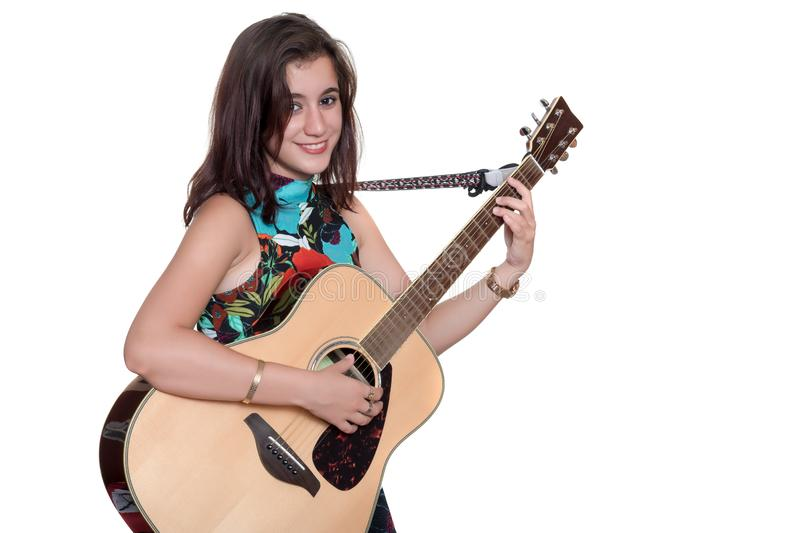Beautiful teenage girl playing an acoustic guita isolated on white stock photo