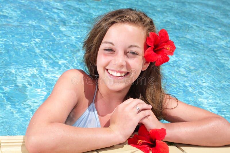 Beautiful teenage girl in swimming pool. Beautiful teenage girl relaxing in swimming pool stock images