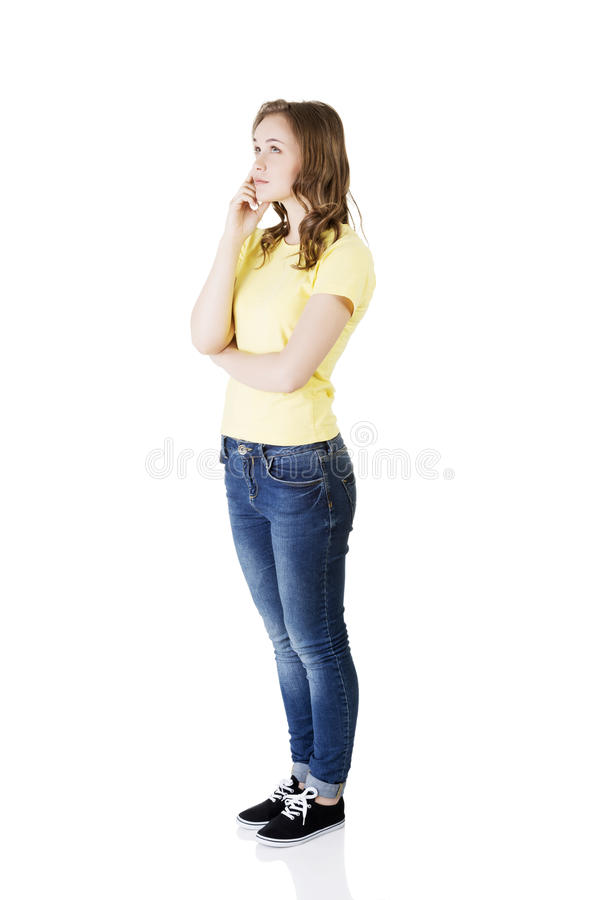 Beautiful teenage girl is thinking stock images