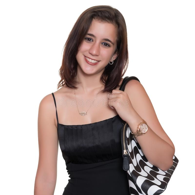 Beautiful teenage girl wearing an elegant black dress isolated on white royalty free stock photos