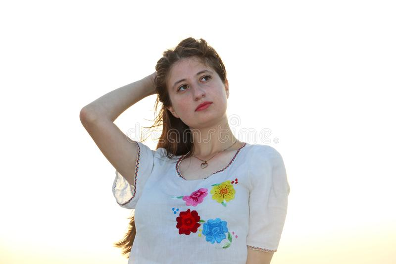 A teenage girl wears white shirt stock images