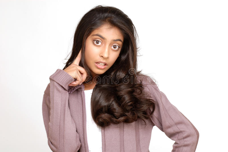Beautiful teenager girl. Beautiful indian teenager girl thinking royalty free stock images