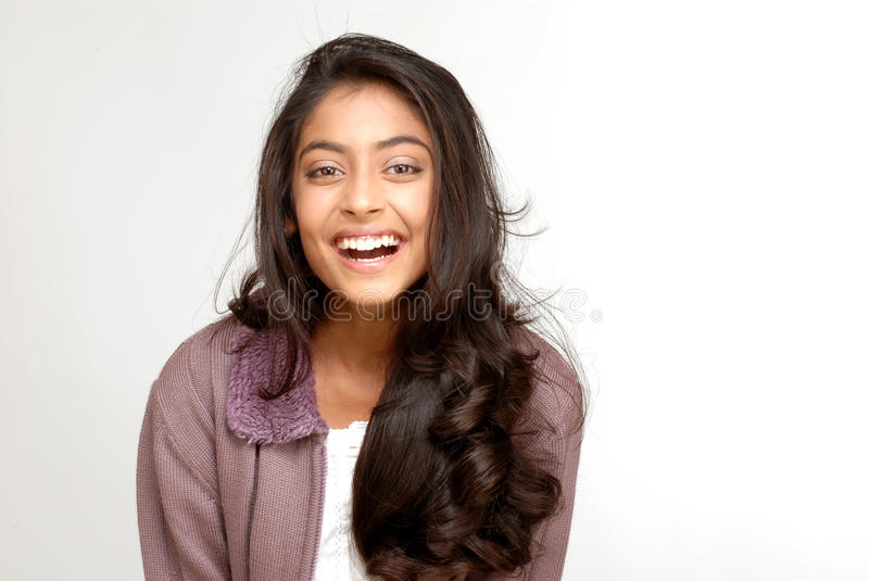 Beautiful teenager girl. Portrait of indian teenager smiling girl over white background stock photos