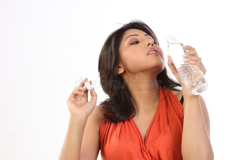 Beautiful Teenager Girl Drinking Water royalty free stock image
