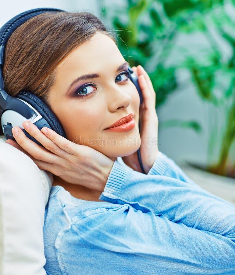 Beautiful teenager girl listening music. stock photography