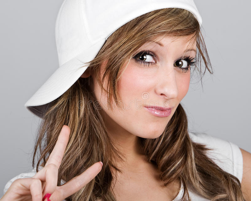 Beautiful Teenager Girl in a White Baseball Cap royalty free stock images