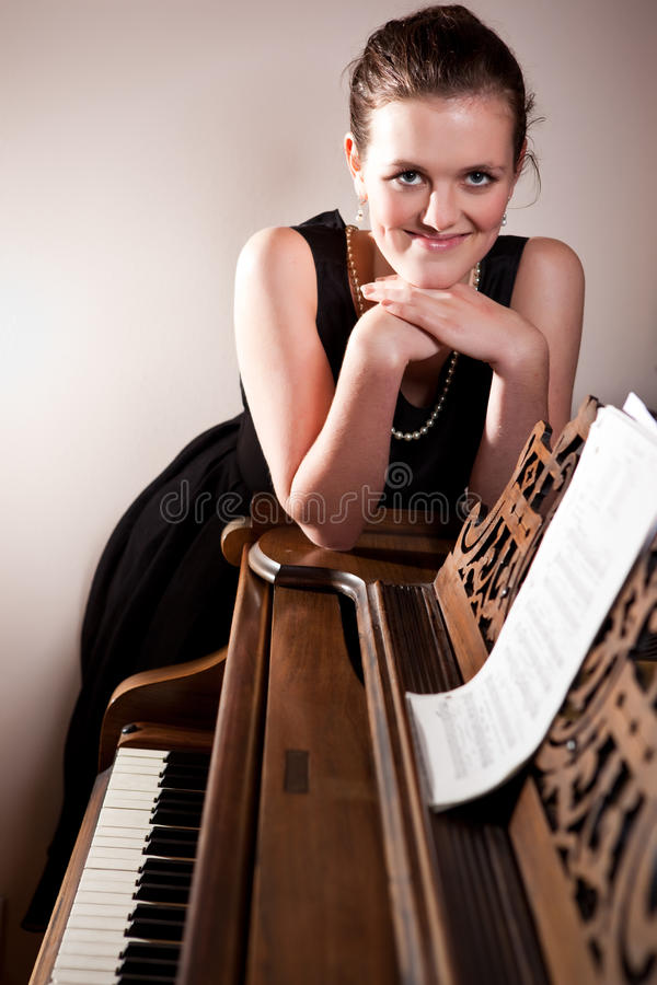 Download Beautiful Teenager Playing Piano Stock Photo - Image: 12564058