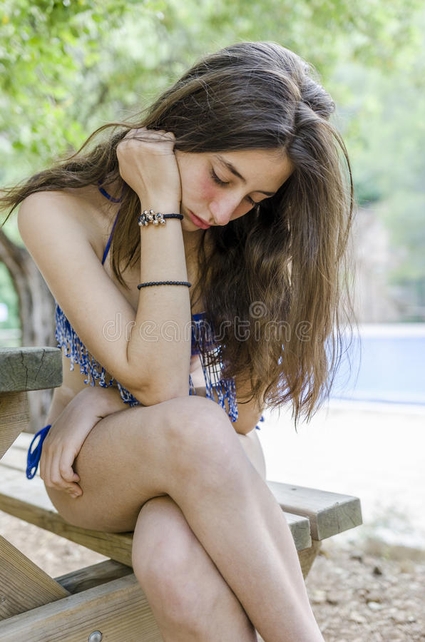 Beautiful teenager relaxed on her holidays, after bathing in the royalty free stock image