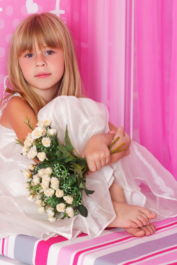 Beautiful tender girl i holds bouquet of flowers stock photo