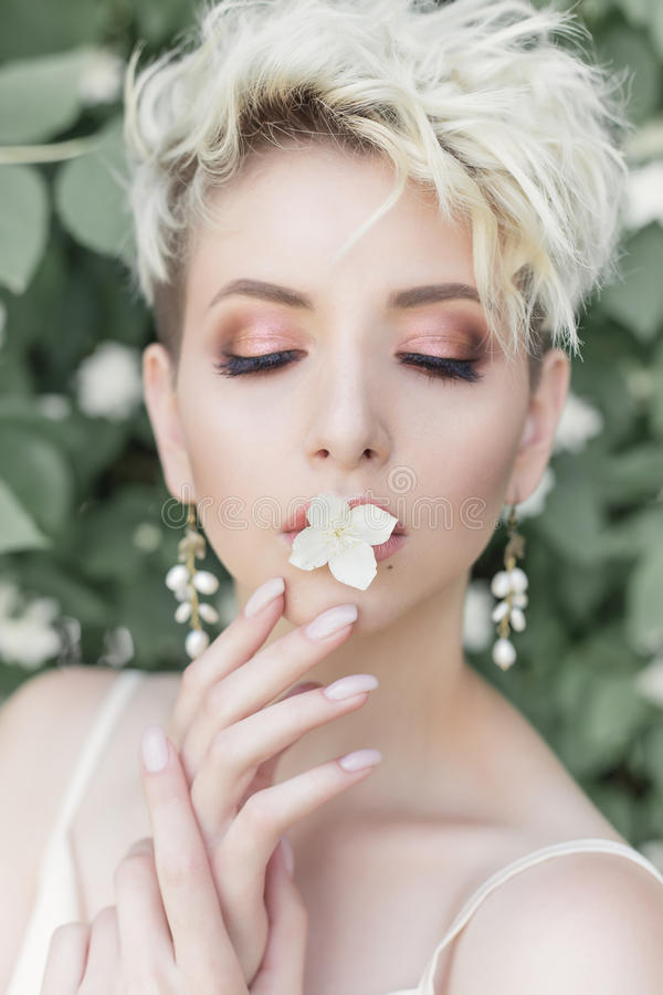 Free Beautiful Tender Girl With Short Haircut In Cream Dress With Jasmine Flower Royalty Free Stock Image - 96309266