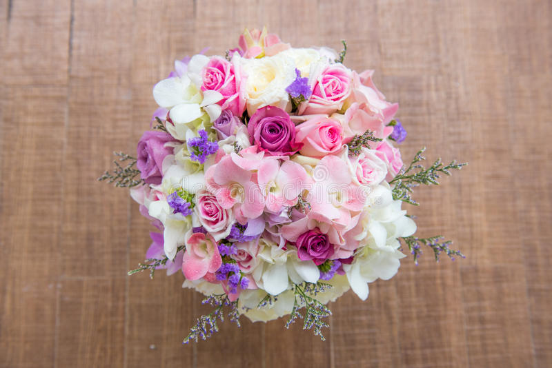 Beautiful tender wedding bouquet of cream roses and eustoma flowers. On floor royalty free stock photography