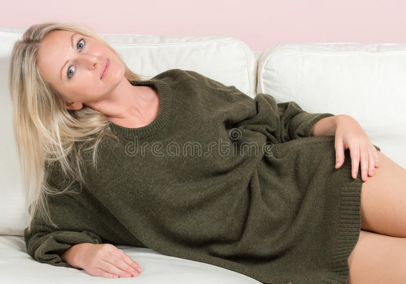 Download Beautiful Tender Woman In Sweater On A Sofa Stock Photo - Image of perfection, looking: 25245730