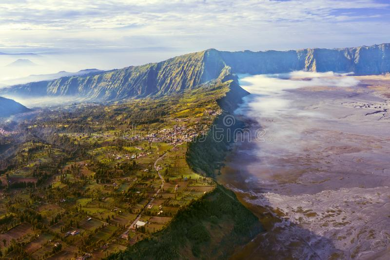 Beautiful Tengger Caldera at misty morning. Beautiful scenery of Tengger Caldera on mount Bromo at misty morning in East Java, Indonesia royalty free stock images