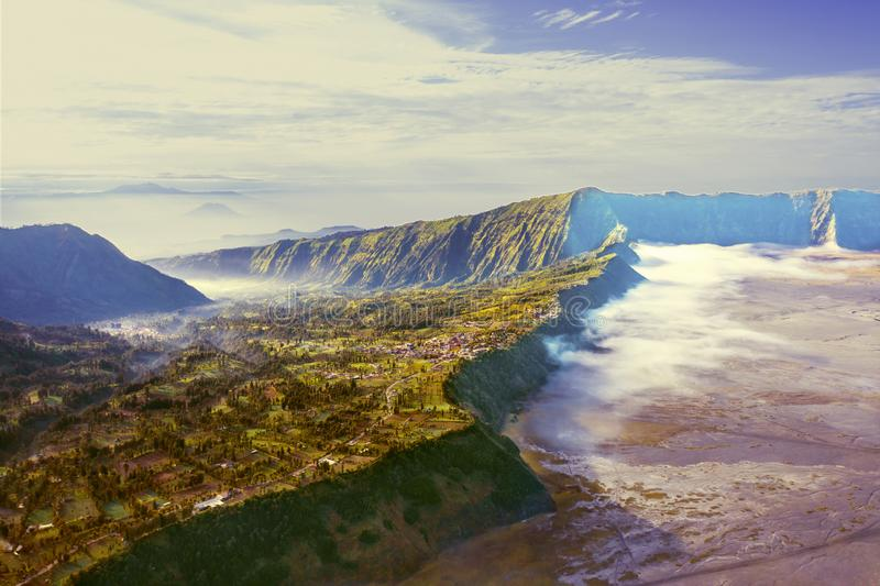 Beautiful Tengger Caldera on mount Bromo. Beautiful aerial view of Tengger Caldera on mount Bromo at misty morning in East Java, Indonesia stock photos