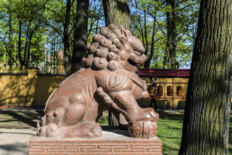 terrible lion in the temple of Buddha, temple of the Buddhists and its Central courtyard. the concept of peaceful religion royalty free stock photography