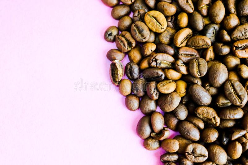 Beautiful texture of freshly roasted selected delicious rich brown natural fragrant coffee tree grains, Arabica coffee beans royalty free stock image