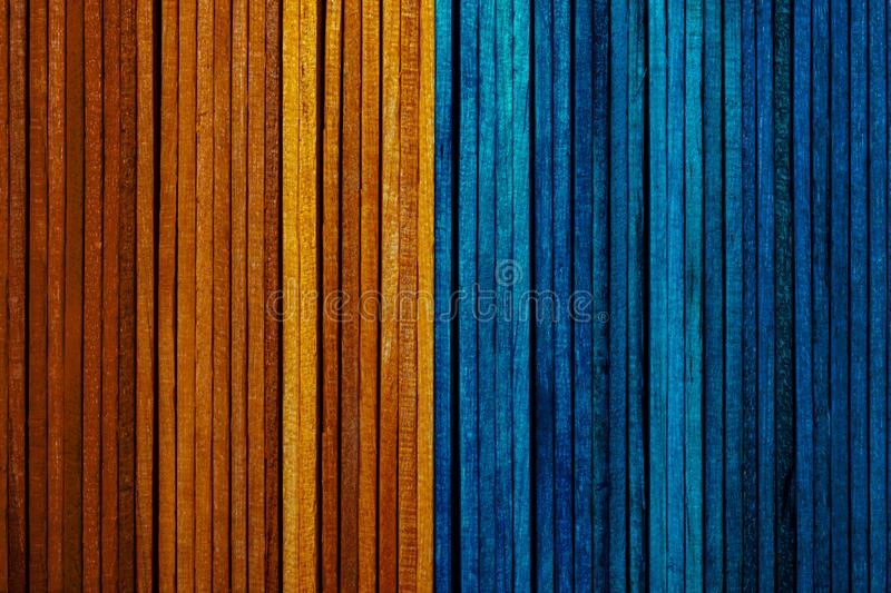 Beautiful texture of natural wood slats of bright orange and blue colors. royalty free stock photography