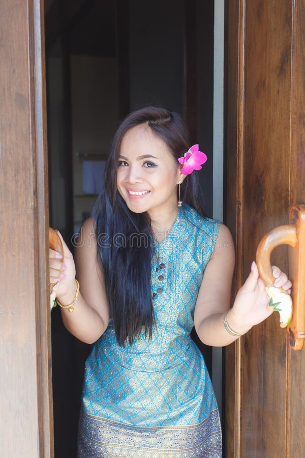 Beautiful thai asian women vintage thailand attire happy smiling open the door in the morning royalty free stock image