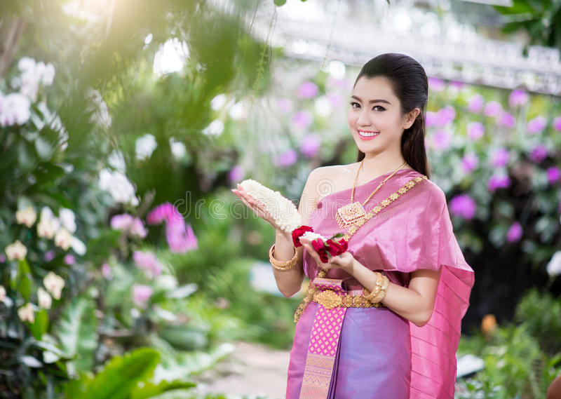 Beautiful Thai girl in Thai traditional costume royalty free stock images