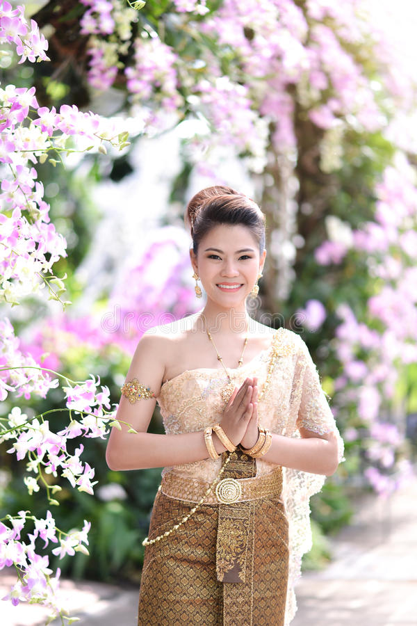Beautiful Thai girl in Thai traditional costume stock image
