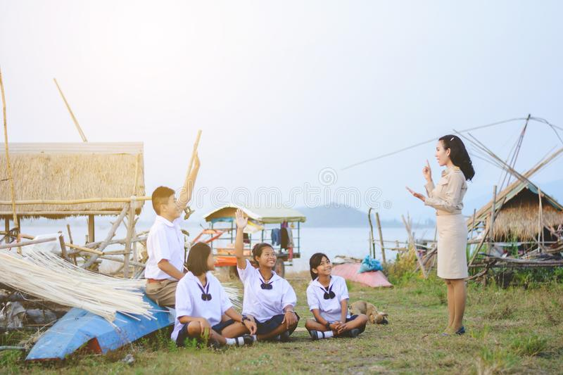 Beautiful Thai Teacher teaching student to learn natural royalty free stock images