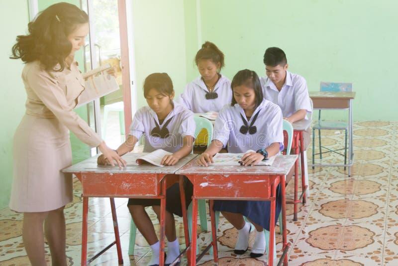 Beautiful Thai Teacher in uniform standing at classroom teaching stock photos