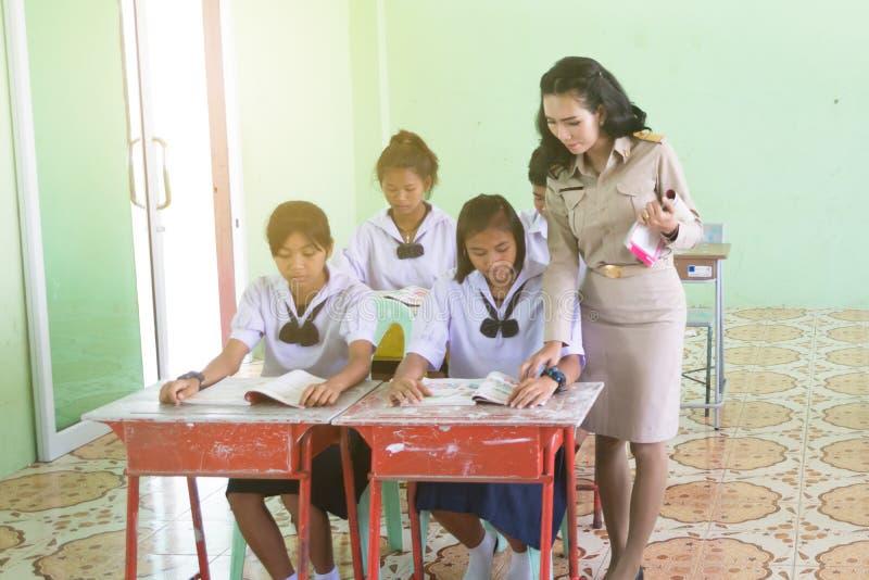 Beautiful Thai Teacher in uniform standing at classroom teaching stock photography