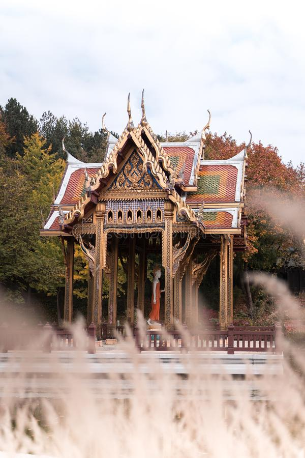 Beautiful thai temple, city park munich, in autmung with nice colors. stock photo