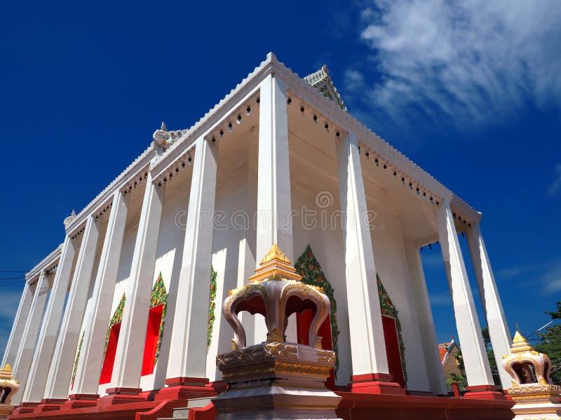 Beautiful Thai temple soars into blue sky stock image