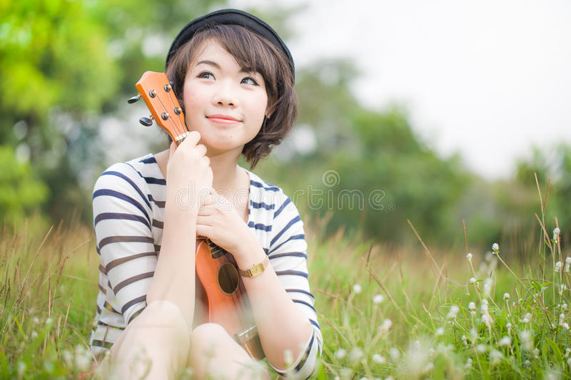 Download Beautiful Thai Woman With Ukulele In Garden Stock Photo - Image: 29019540